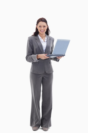 19's: Businesswoman looking happy with a laptop against white background
