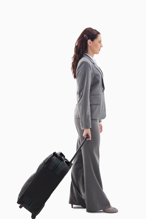 19's: Profile of a businesswoman with a suitcase against white background
