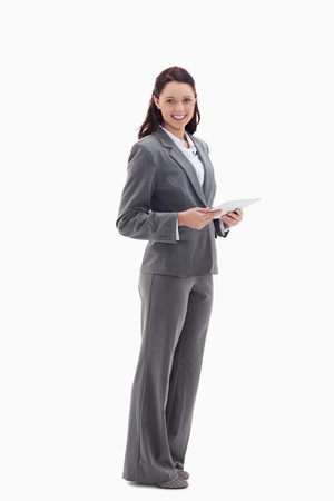 Profile of a businesswoman with a touch pad against white background photo