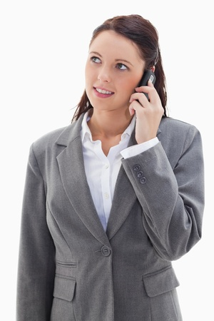 19's: Businesswoman on the phone looking up against white background