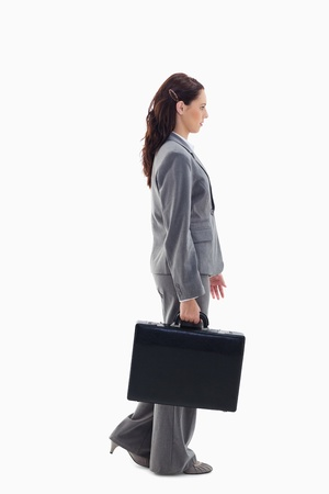 19's: Profile of a businesswoman walking with a briefcase against white background