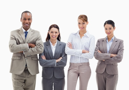 19's: Close-up of a business team smiling side by side and crossing their arms against white background Stock Photo