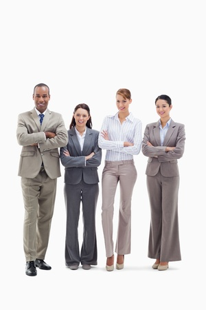 Business team smiling side by side and crossing their arms against white background photo