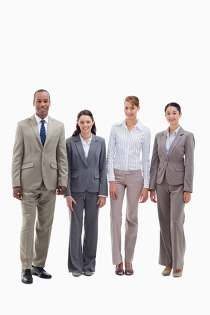 19's: Business team smiling side by side against white background Stock Photo