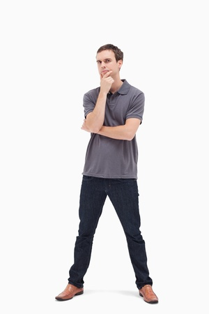 legs apart: Thoughtful standing man with his legs apart against white background Stock Photo