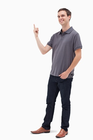 man pointing up: Happy man standing and presenting something above against white background