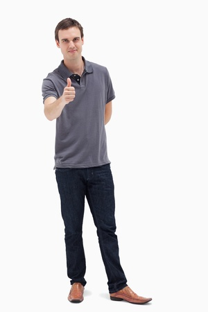 Man approving with his thumb up against white background Stock Photo - 13603671