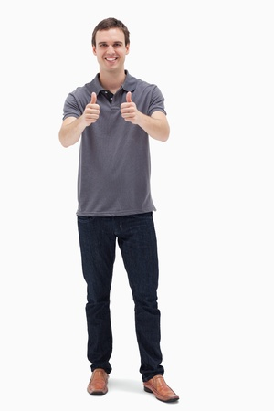Man approving with his thumbs up against white background Stock Photo - 13603786