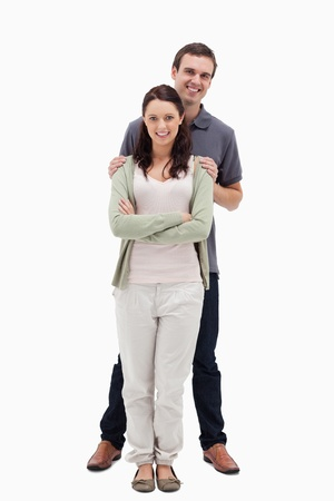 19's: Man holding woman by the shoulders against white background Stock Photo
