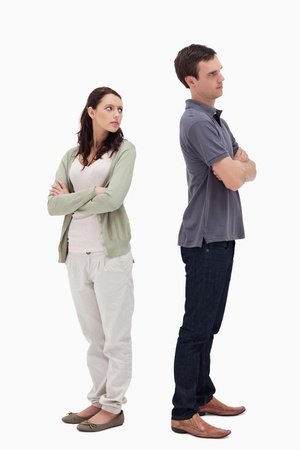 Couple in disagreement against white background photo