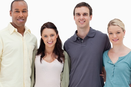 Close-up of two couples smiling against white background photo