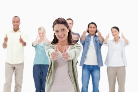 positivism: Close-up de la gente con su pulgar hacia arriba se centran en la mujer en primer plano Foto de archivo