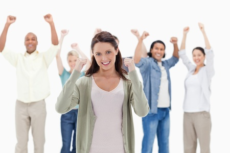 raise hand: Happy people raising their arms focus on the woman in foreground Stock Photo