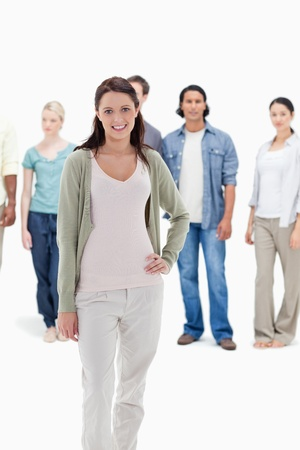 19's: Close-up of people behind a smiling woman with her hand on her hip against white background Stock Photo