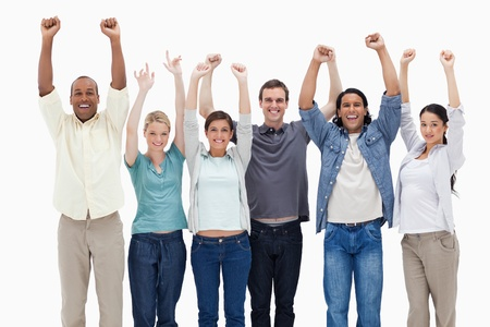 People raising their arms against white background photo