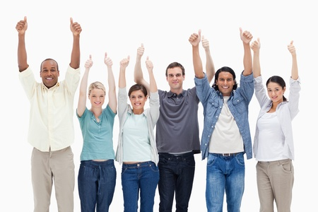 People raising their arms with the thumbs-up against white background photo