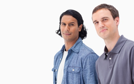 Close-up of two men against white background photo