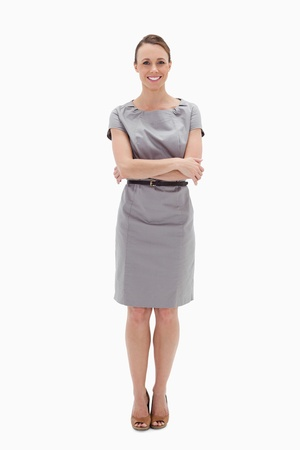 Woman in dress smiling with her arms folded against white background Stock Photo - 13600447