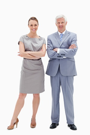 White hair man with woman crossing their arms and smiling against white background photo