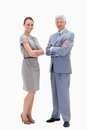 White hair man face to face with a woman crossing their arms and smiling against white background photo