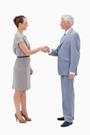 White hair man face to face with a woman and shaking hands against white background photo