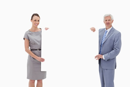 White hair businessman holding a big white sign with a woman against white background Stock Photo - 13601838