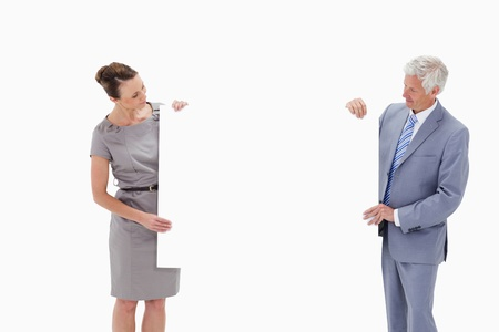 White hair businessman looking and holding a big white sign with a woman against white background Stock Photo - 13601865