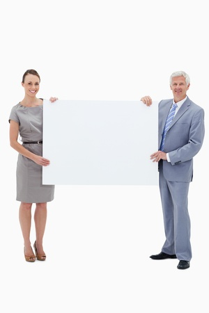 White hair businessman smiling and holding a big white sign with a woman against white background Stock Photo - 13602565