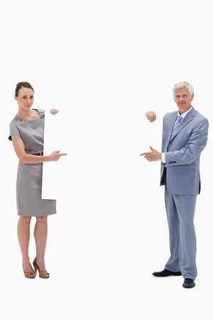 White hair businessman holding and pointing to a big white sign with a woman against white background Stock Photo - 13600528