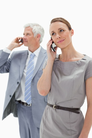 Close-up of a woman making a call with a white hair businessman in background photo