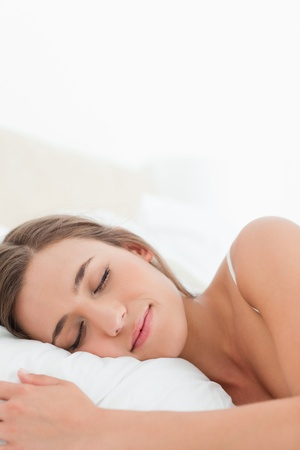 A close up shot of a woman sleeping with her head on the pillow. Stock Photo - 13650102
