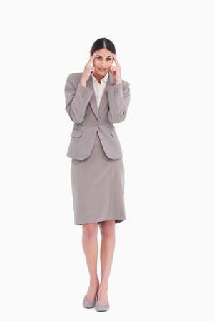 Businesswoman rubbing her temples against a white background photo