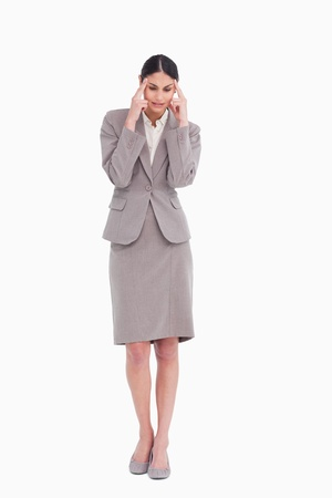 Businesswoman experiencing a headache against a white background photo