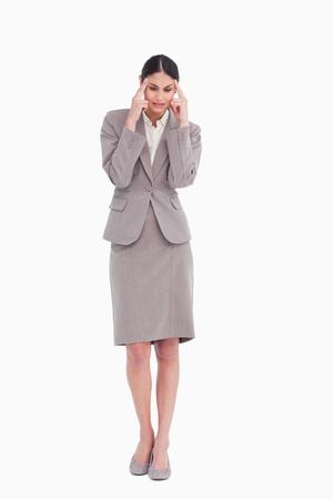 Businesswoman experiencing a headache against a white background photo