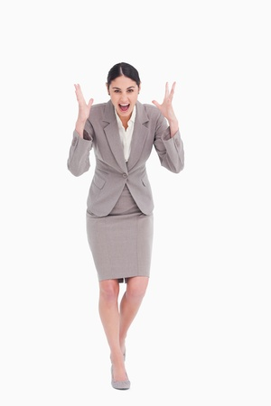 Angry businesswoman shouting against a white background photo