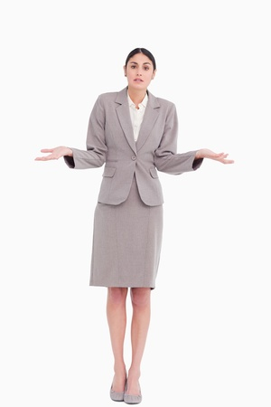 Young businesswoman clueless against a white background Stock Photo - 13648255