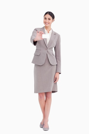 Smiling businesswoman with her blank businesscard against a white background Stock Photo - 13648192