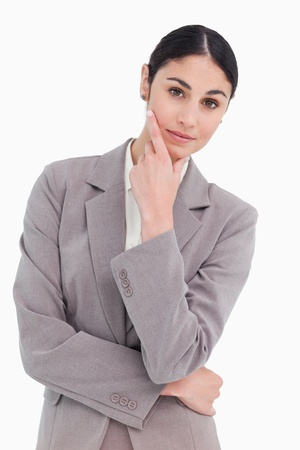 Young businesswoman in thinkers pose against a white background Stock Photo - 13673841