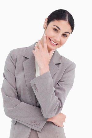 thinkers: Smiling businesswoman in thinkers pose against a white background