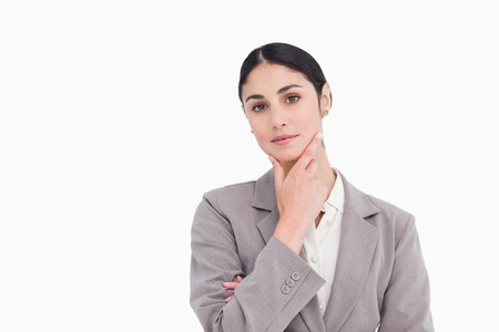thinkers: Young saleswoman in thinkers pose against a white background Stock Photo