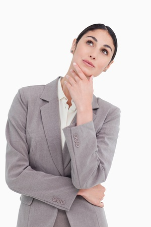 Saleswoman in thinkers pose against a white background Stock Photo - 13673717