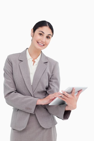 Smiling tradeswoman with her tablet computer against a white background Stock Photo - 13659134