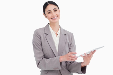 Smiling young saleswoman with her tablet computer against a white background Stock Photo - 13650491