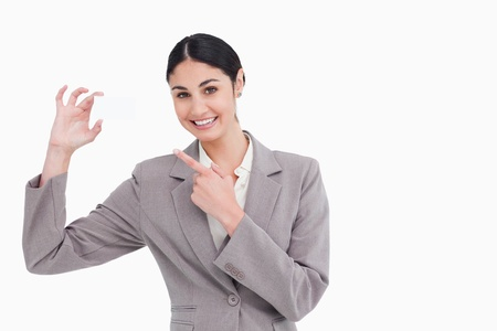 Smiling saleswoman pointing at her business card against a white background Stock Photo - 13650252