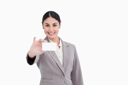 Smiling saleswoman presenting her business card against a white background photo