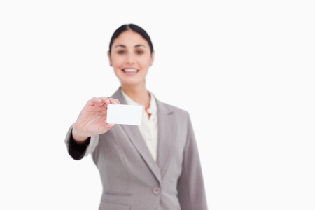 Blank business card being presented by saleswoman against a white background photo
