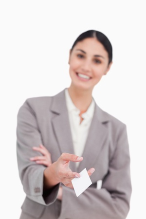 Business card being handed over by smiling saleswoman against a white background photo
