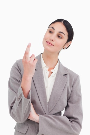 Businesswoman looking at her fingertips against a white background photo