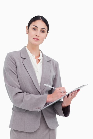 Businesswoman ready to take notes against a white background photo