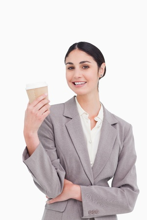 Smiling businesswoman with coffee in a paper cup against a white background photo